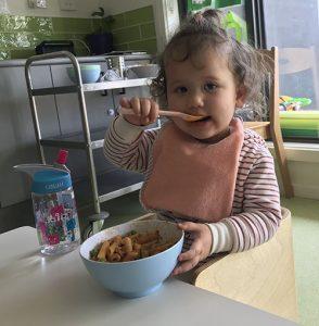 baby feeding herself