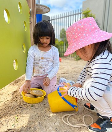 playing in sandpit childcare hoppers crossing